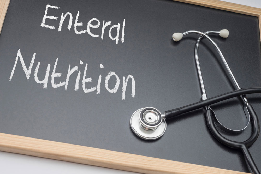 Enteral nutrition written on a blackboard, conceptual image, horizontal composition