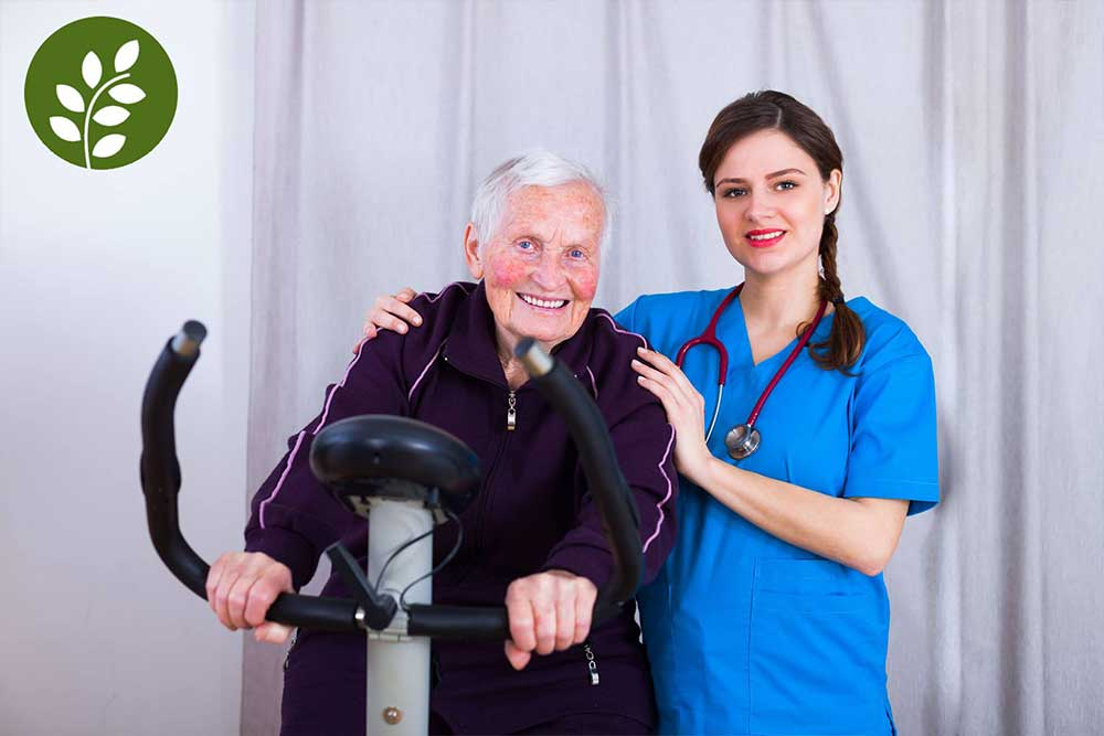 Kind nurse attending a senior woman's training in a nursing home.