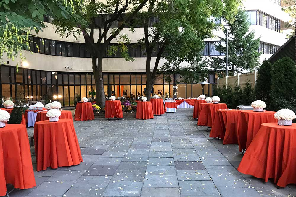 Beautifully decorated outdoor space at Morningside with tables, flowers, and table clothes.