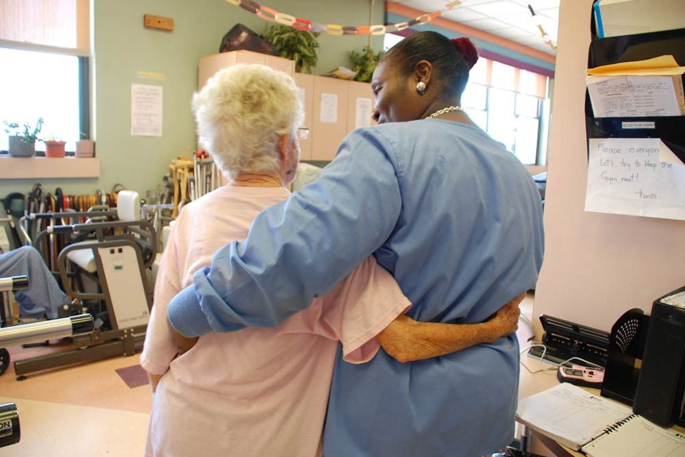 Caretaker hugging resident at Morningside Nursing and Rehabilitation Center.