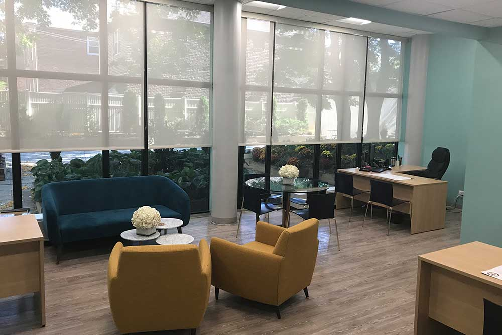 Tables, chairs, comfortable couches, and sitting area located at Morningside Nursing and Rehabilitation Center.