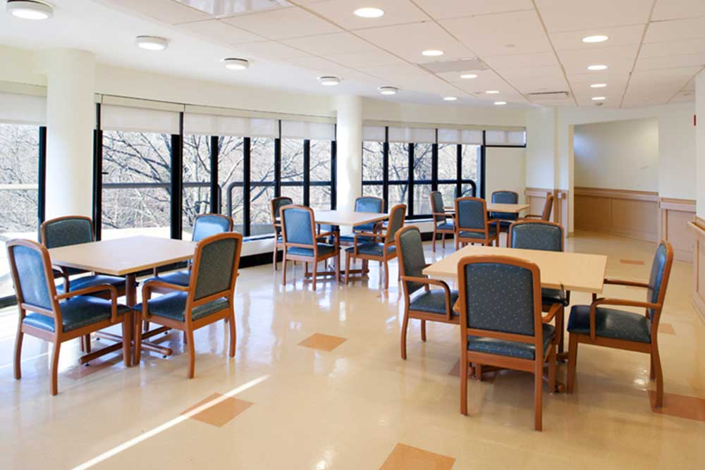 Interior room at Morningside facility, showing waiting room area with tables and chairs.