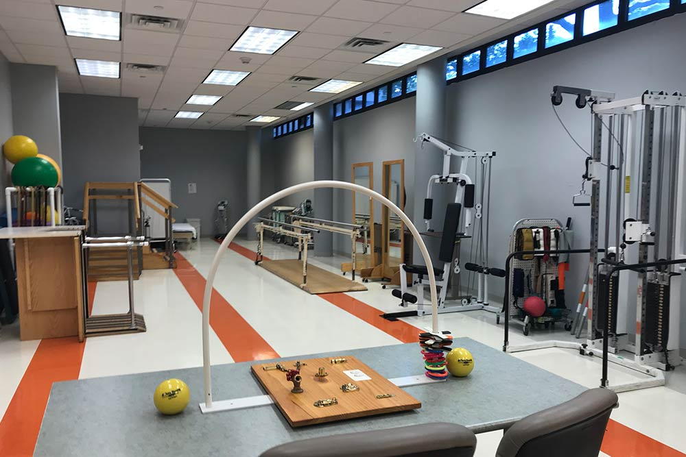 Exercise room filled with physical therapy equipment at Morningside facility.